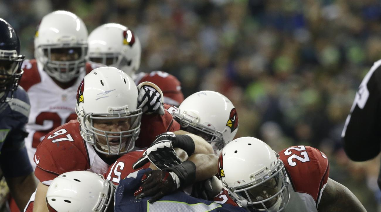 FILE - In this Nov. 15, 2015, file photo, Seattle Seahawks running back Marshawn Lynch (24) is tackled by a host of Arizona Cardinals players in the first half of an NFL football game in Seattle. On a Sunday night seven weeks ago, the Cardinals pulled off