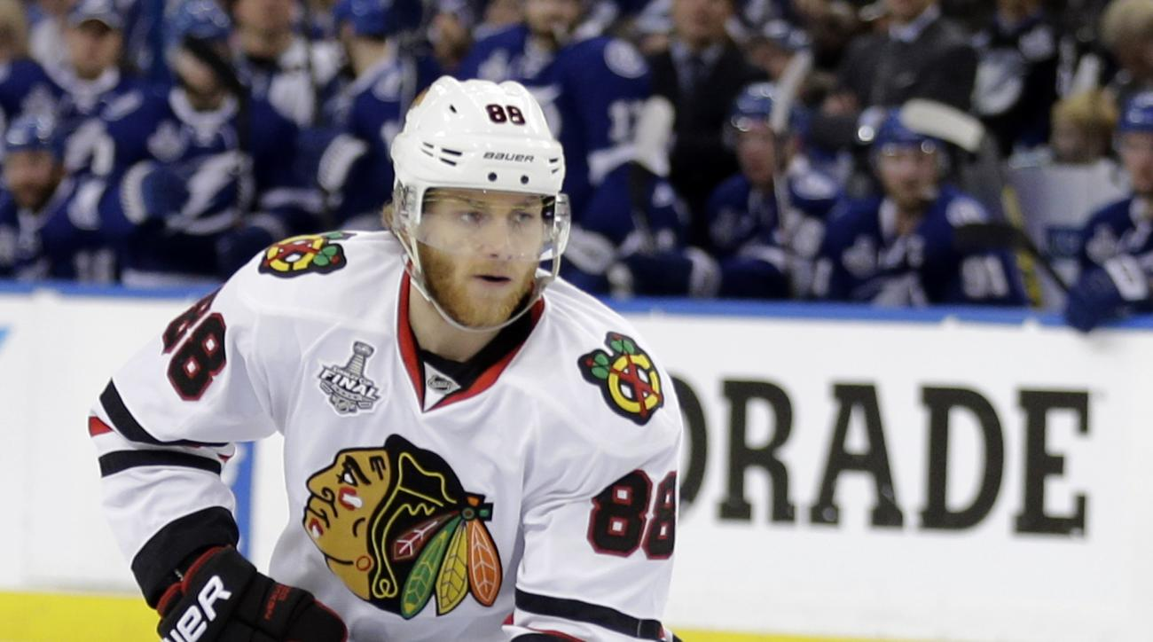 """FILE - In this June 6, 2015, file photo, Chicago Blackhawks right wing Patrick Kane skates against the Tampa Bay Lightning during the second period in Game 2 of the NHL hockey Stanley Cup Final in Tampa, Fla. The NHL says it is """"following developments"""" of"""