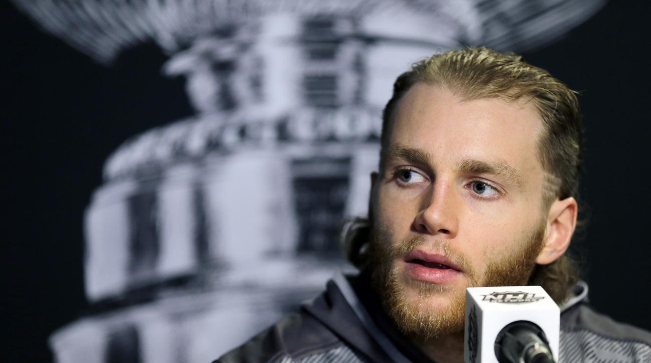 FILE - In this June 2, 2015, file photo, Chicago Blackhawks right wing Patrick Kane answers a question during media day for NHL hockey's Stanley Cup finals  in Tampa, Fla. The police investigation of Blackhawks star Patrick Kane concerns something that ha