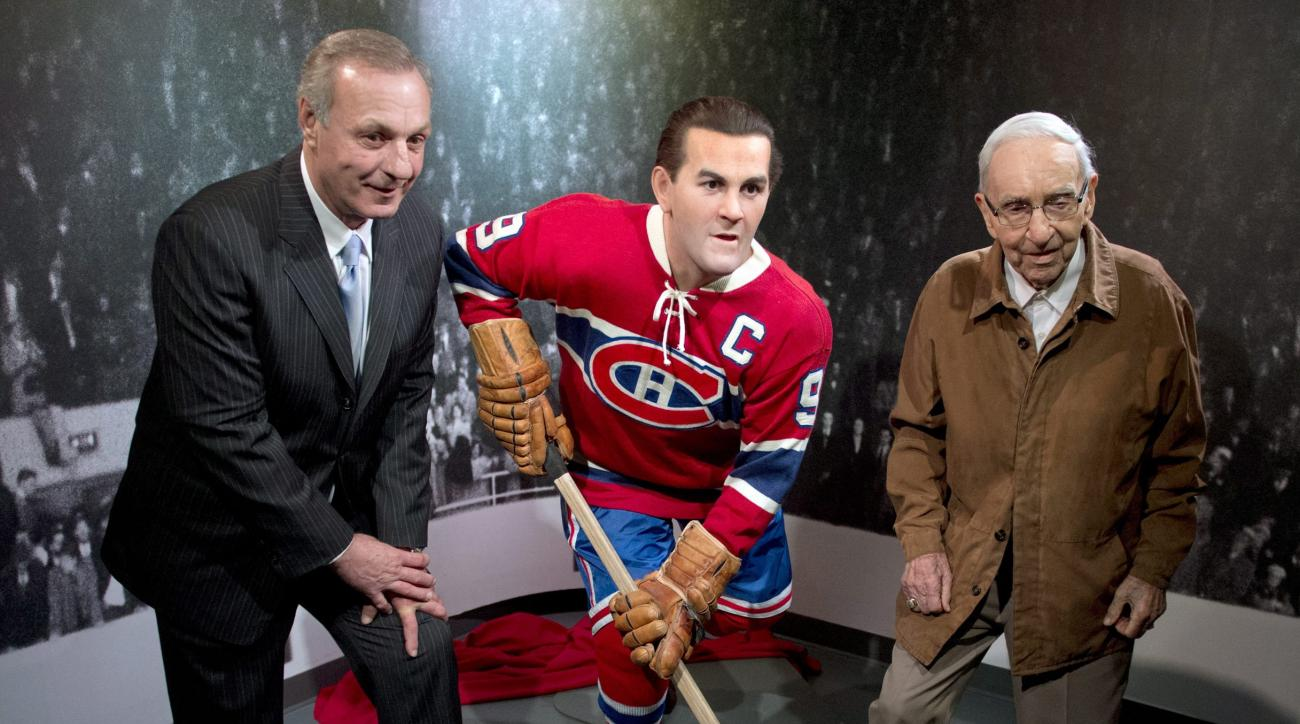 "FILE - In this April 10, 2014, file photo, former Montreal Canadiens Guy Lafleur, left, and Bob Fillion, right, pose with a wax statue of Maurice ""Rocket"" Richard at the unveiling at the Montreal Canadiens Hall of Fame in Montreal. Fillion, who won the St"
