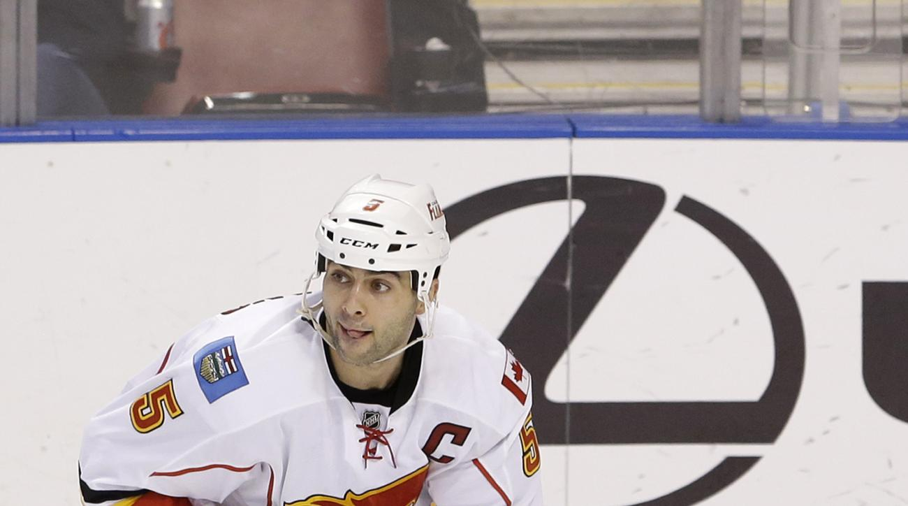 Calgary Flames defenseman Mark Giordano is shown during the second period of an NHL hockey game against the Florida Panthers, Saturday, Nov. 8, 2014 in Sunrise, Fla. (AP Photo/Wilfredo Lee)