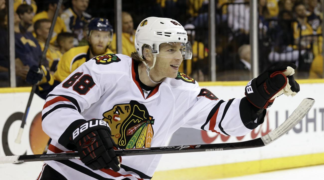 FILE - In this Friday, April 17, 2015 file photo, Chicago Blackhawks right wing Patrick Kane (88) celebrates after scoring a goal against the Nashville Predators in the second period of Game 2 of an NHL Western Conference hockey playoff series in Nashvill