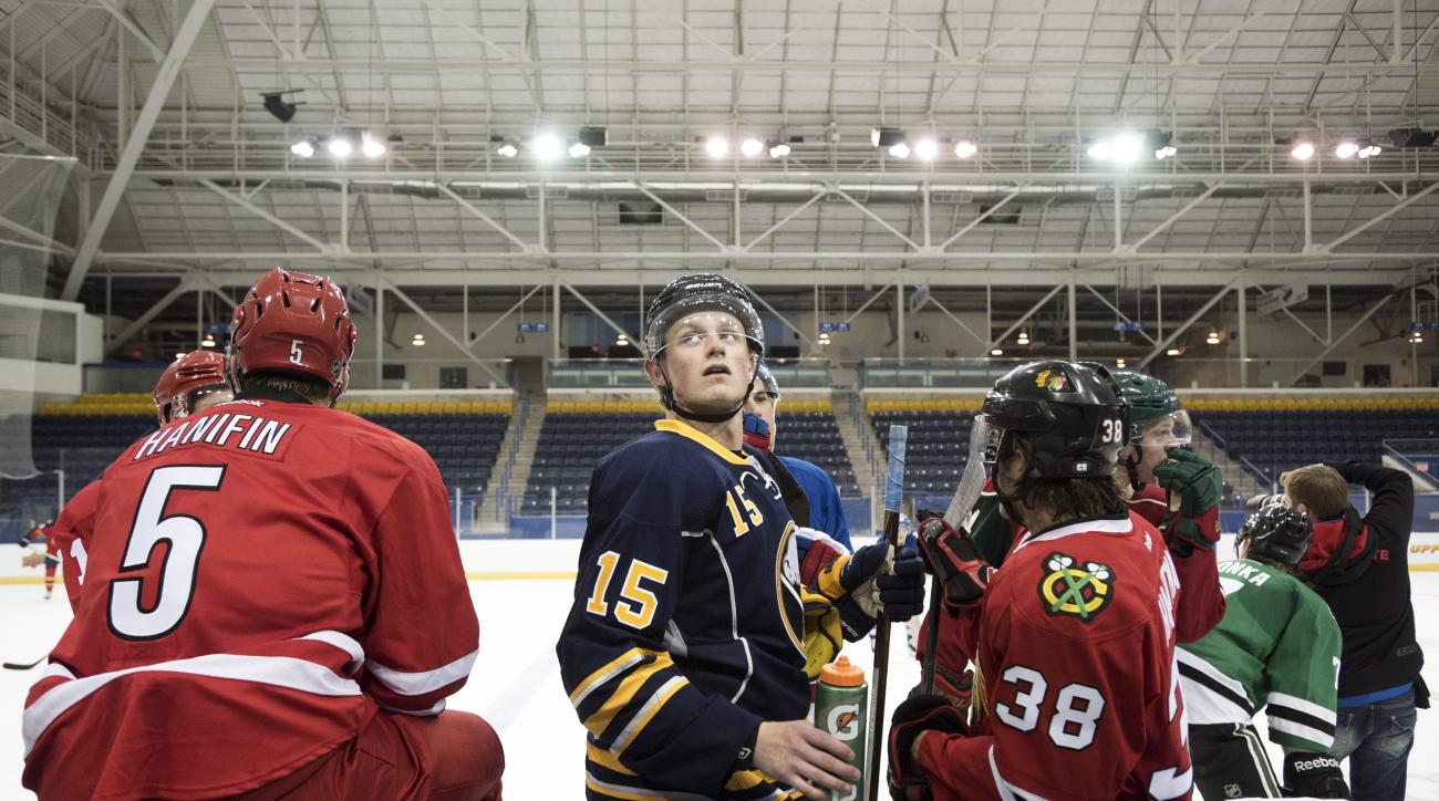 "FILE - In this Sept. 1, 2015, file photo, Buffalo Sabres' Jack Eichel, center, looks up during the National Hockey League Players Association (NHLPA) Rookie Showcase in Toronto. Sabres fans have taken a liking to ""Eich.""  As consolations prizes go, the Sa"