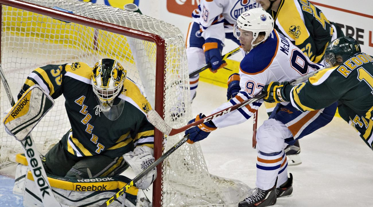 Edmonton Oilers' Connor McDavid (97) is stopped by University of Alberta goalie Luke Siemens (30) during the third period of an exhibition hockey game Wednesday, Sept. 16, 2015, in Edmonton, Alberta. (Jason Franson/The Canadian Press via AP)