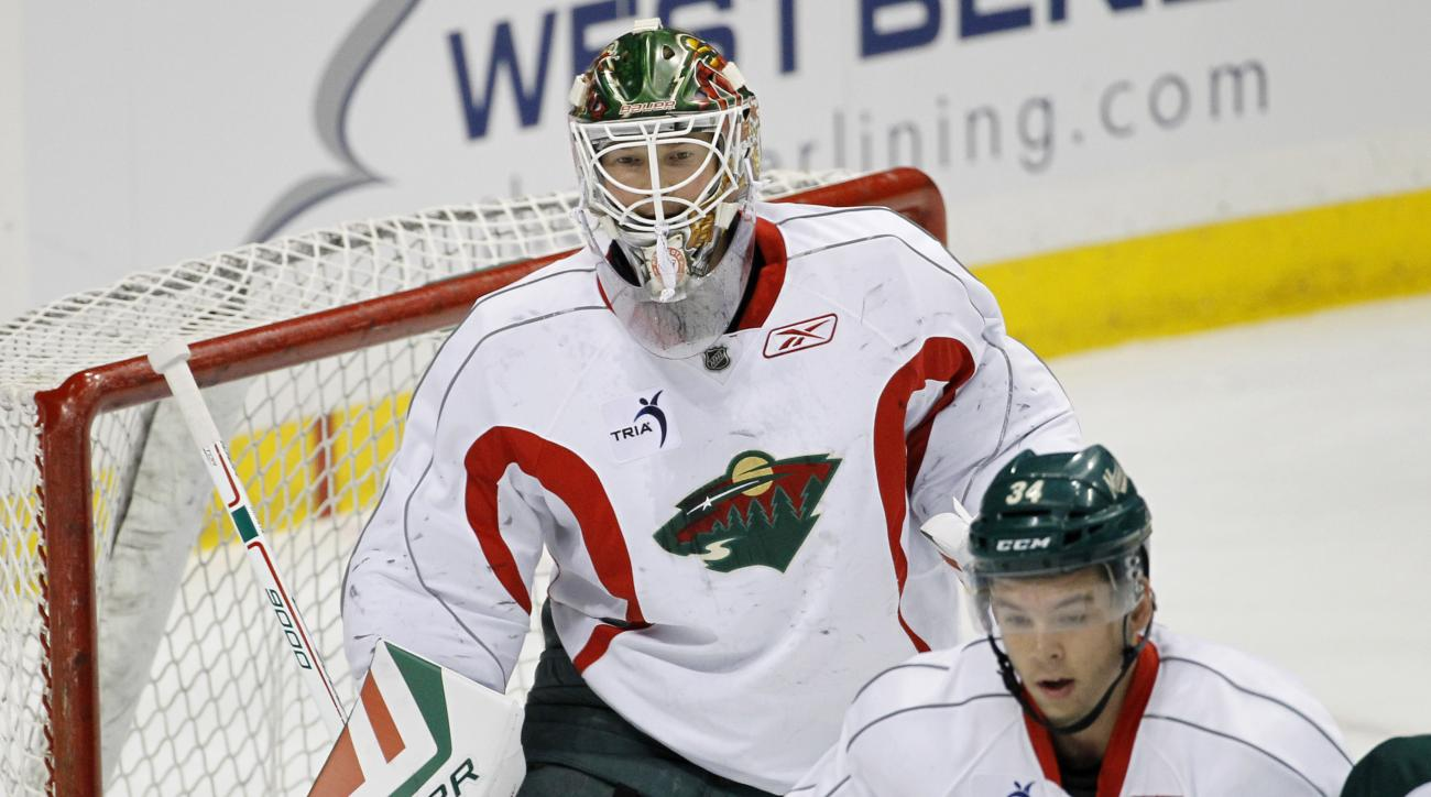 Minnesota Wild goalie Devan Dubnyk covers the net during NHL hockey training camp in St. Paul, Minn., Friday, Sept. 18, 2015. (AP Photo/Ann Heisenfelt)