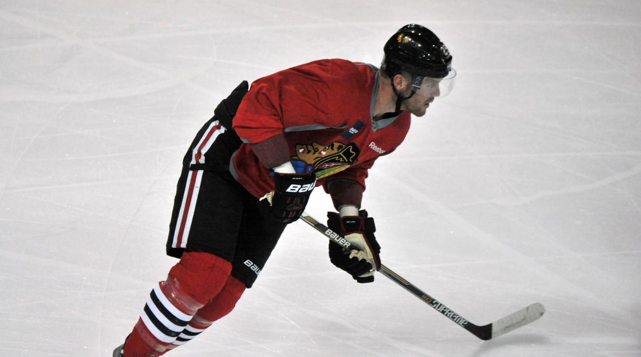 RETRANSMISSION TO CORRECT NAME TO BRYAN BICKELL FROM RYAN BICKELL - Chicago Blackhawks' Bryan Bickell skates during NHL hockey training camp at the Compton Family Ice Center on the campus of the University of Notre Dame in South Bend, Ind., Friday, Sept.