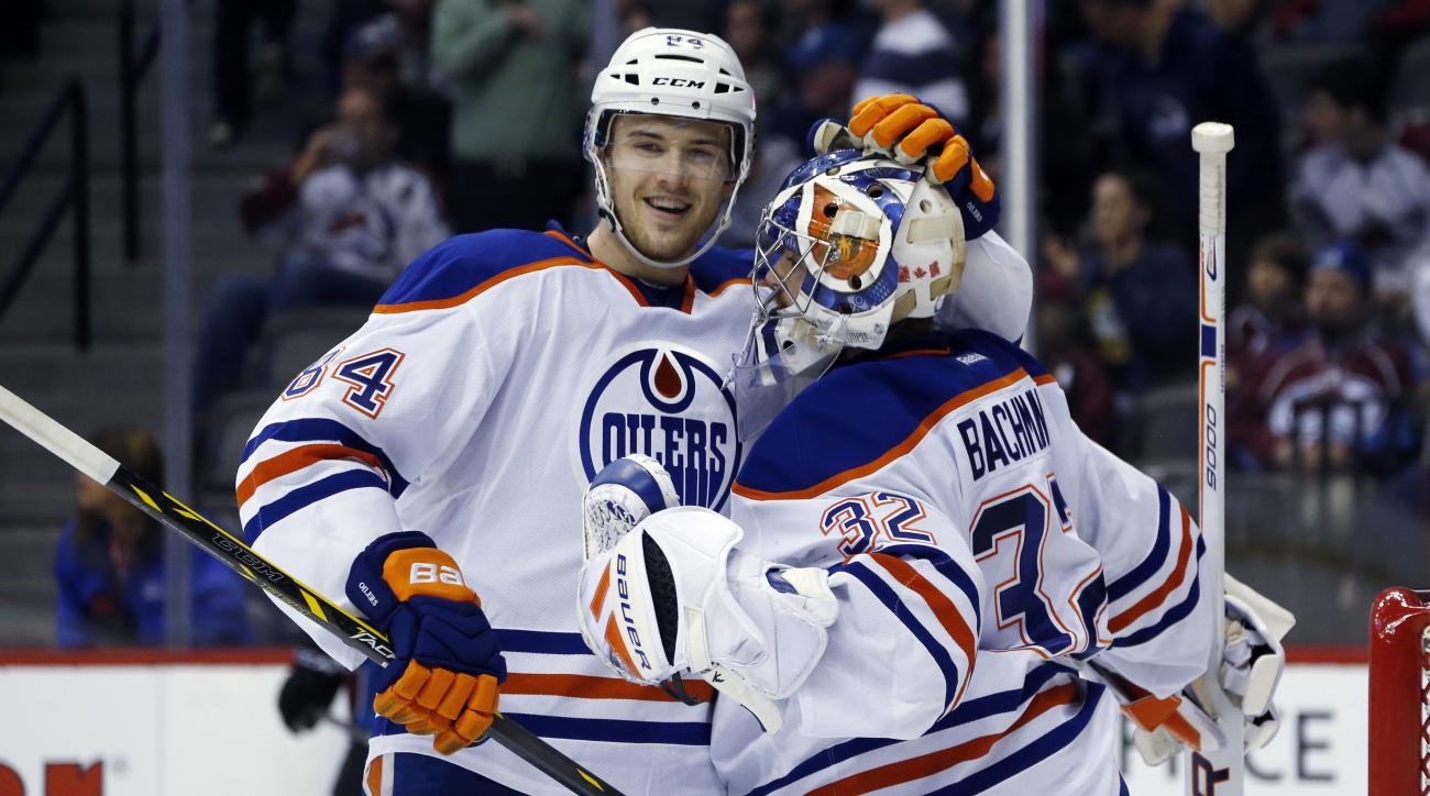 Edmonton Oilers defenseman Oscar Klefbom, left, of Sweden, congratulates goalie Richard Bachman as time runs out in the third period of an NHL hockey game against the Colorado Avalanche, Monday, March 30, 2015, in Denver. The Oilers won 4-1. (AP Photo/Dav