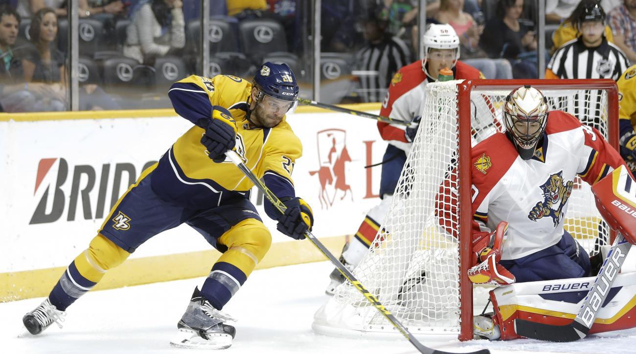 Nashville Predators center Paul Gaustad (28) shoots against Florida Panthers goalie Mike McKenna in the second period of a preseason NHL hockey game Sunday, Sept. 20, 2015, in Nashville, Tenn. (AP Photo/Mark Humphrey)