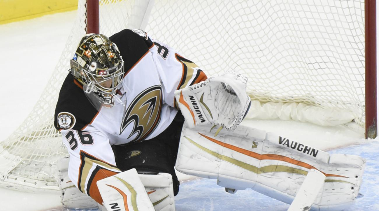 Anaheim Ducks goaltender John Gibson deflects the puck during the second period of an NHL hockey game against the New Jersey Devils Sunday, March 29, 2015, in Newark, N.J. (AP Photo/Bill Kostroun)