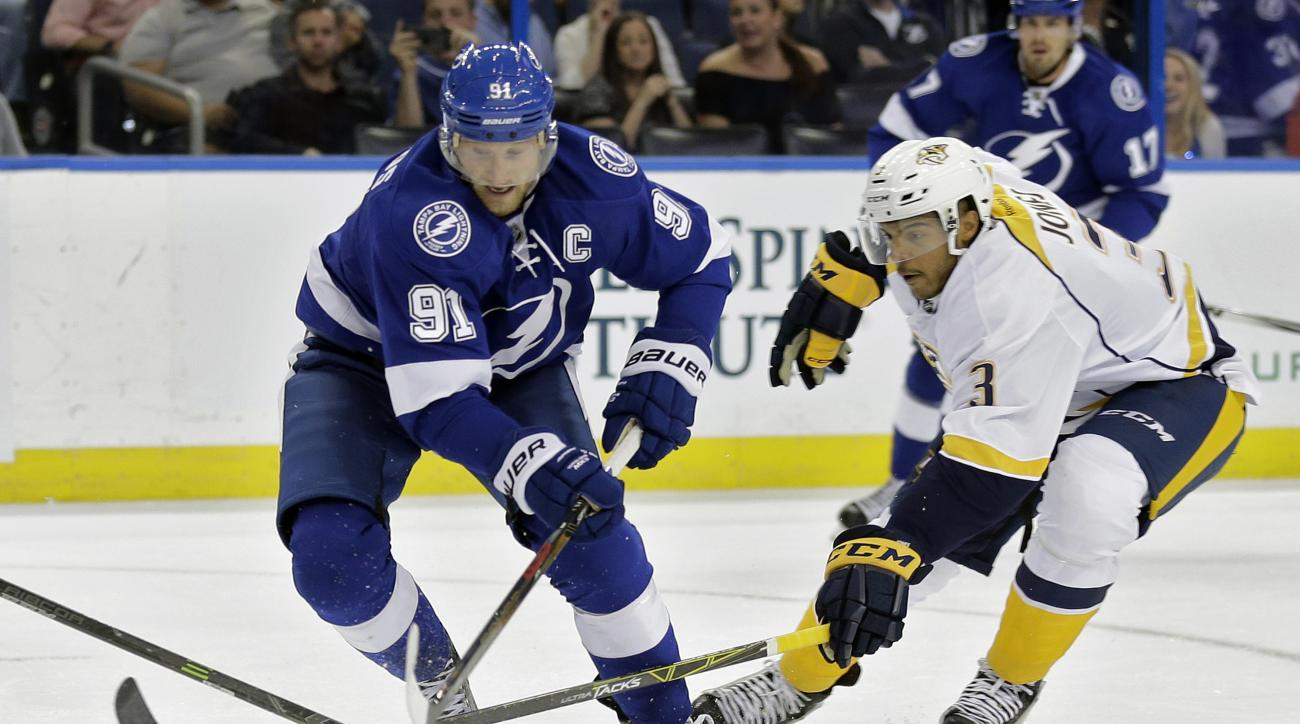 Tampa Bay Lightning center Steven Stamkos (91) loses the puck to Nashville Predators defenseman Seth Jones (3) during the second period of an NHL preseason hockey game Tuesday, Sept. 22, 2015, in Tampa, Fla. (AP Photo/Chris O'Meara)