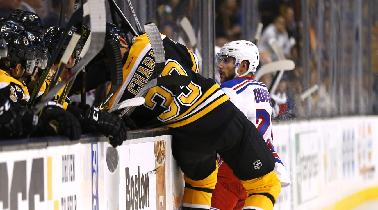 Boston Bruins defenseman Zdeno Chara is checked into the boards by New York Rangers' Ryan Bourque during the first period of an NHL preseason hockey game in Boston on Thursday, Sept. 24, 2015. Ciara was injured on the play and left the game. (AP Photo/Win