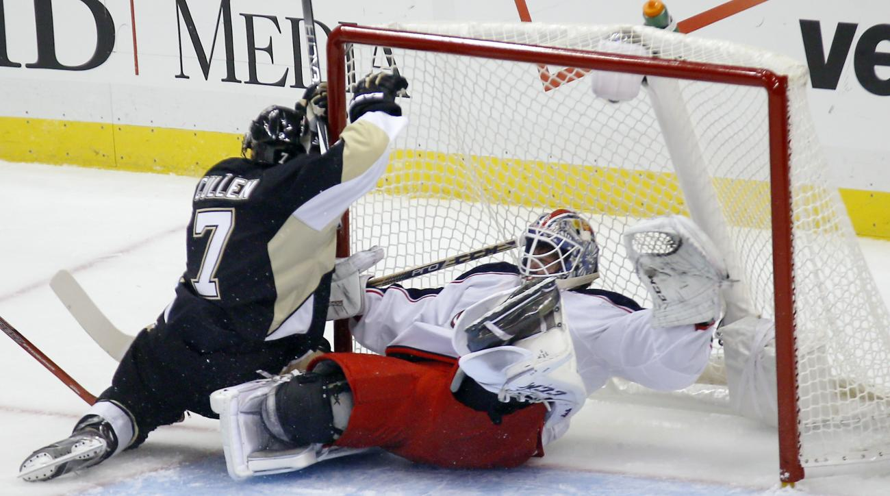 Pittsburgh Penguins' Matt Cullen (7) runs into Columbus Blue Jackets goalie Sergei Bobrovsky after trying to score during the first period of an NHL preseason hockey game, Saturday, Sept. 26, 2015, in Pittsburgh. Cullen was penalized for goalie interferen