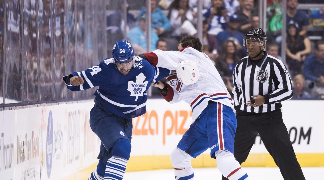 Toronto Maple Leafs defenseman Mark Fraser, left, and Montreal Canadiens forward Zack Kassian fight during the first period of an NHL preseason hockey game, Saturday, Sept. 26, 2015 in Toronto. (Darren Calabrese/The Canadian Press via AP) MANDATORY CREDIT