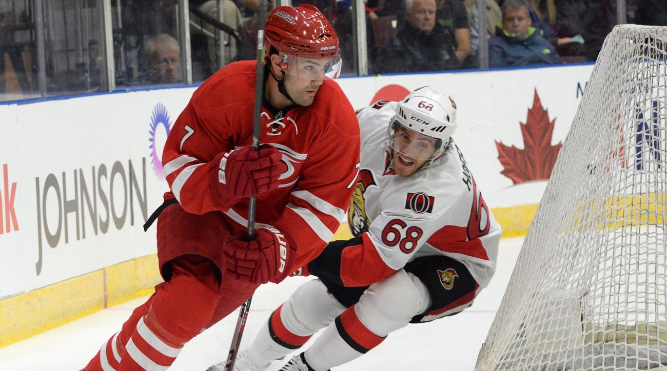 Caroline Hurricanes' Ryan Murphy, left, is chased by Ottawa Senators' Mike Hoffman during an exhibition NHL hockey game in St. John's, Newfoundland, Sunday, Sept. 27, 2015. (Keith Gosse/The Canadian Press via AP)