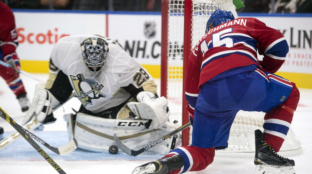 Montreal Canadiens' Tomas Fleischmann, right, shoots on Pittsburgh Penguins' goalie Marc Andre Fleury during the second period of a preseason NHL hockey game Monday, Sept. 28, 2015, in Quebec. (Jacques Boissinot/The Canadian Press via AP) MANDATORY CREDIT
