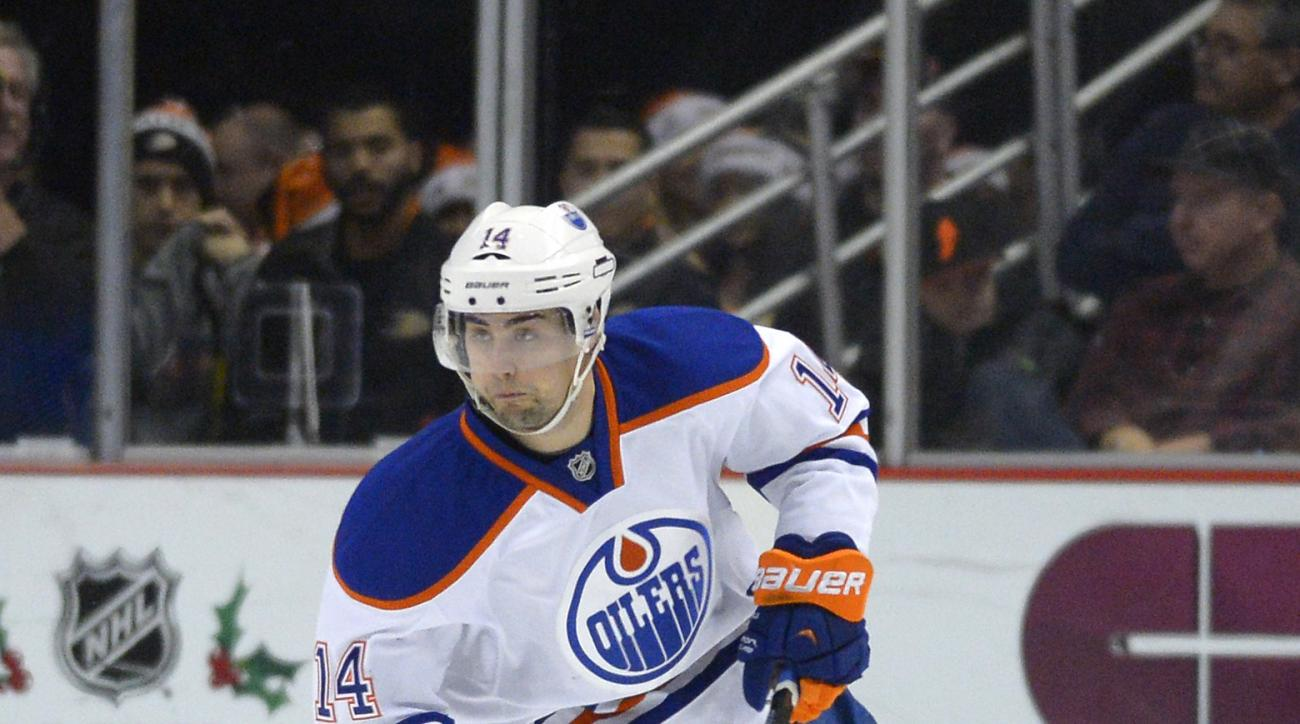 Edmonton Oilers right wing Jordan Eberle skates with the puck during the third period of an NHL hockey game against the Anaheim Ducks, Sunday, Dec. 15, 2013, in Anaheim, Calif. The Ducks won 3-2. (AP Photo/Mark J. Terrill)
