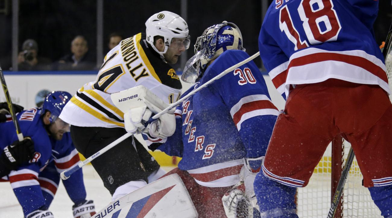 Boston Bruins right wing Brett Connolly (14) scores a goal past New York Rangers goalie Henrik Lundqvist (30) during the first period of an NHL preseason hockey game at Madison Square Garden in New York, Wednesday, Sept. 30, 2015. (AP Photo/Adam Hunger)