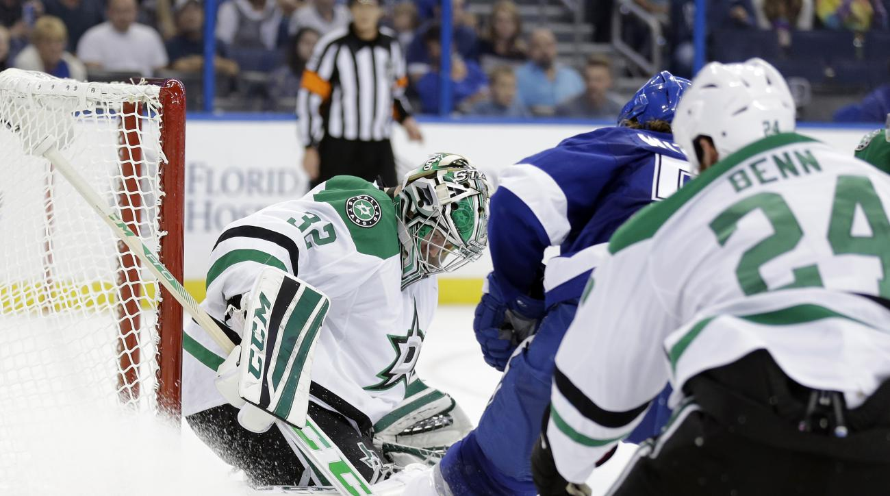 Dallas Stars goalie Kari Lehtonen (32) makes a save on a shot by Tampa Bay Lightning defenseman Luke Witkowski during the second period of an NHL preseason hockey game Thursday, Oct. 1, 2015, in Tampa, Fla. Trailing the play is Stars' Jordie Benn (24).(AP