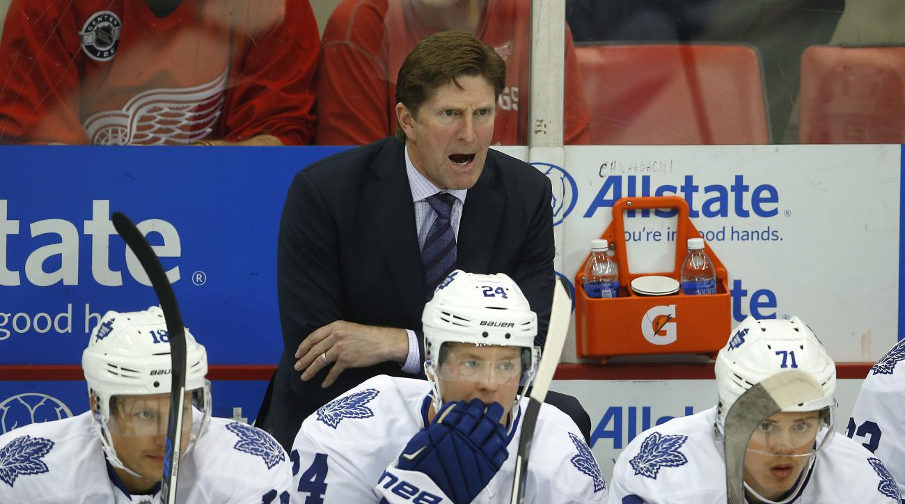 Toronto Maple Leafs head coach Mike Babcock gives instruction from the bench against the Detroit Red Wings in the first period of a preseason NHL hockey game in Detroit Friday, Oct. 2, 2015. (AP Photo/Paul Sancya)