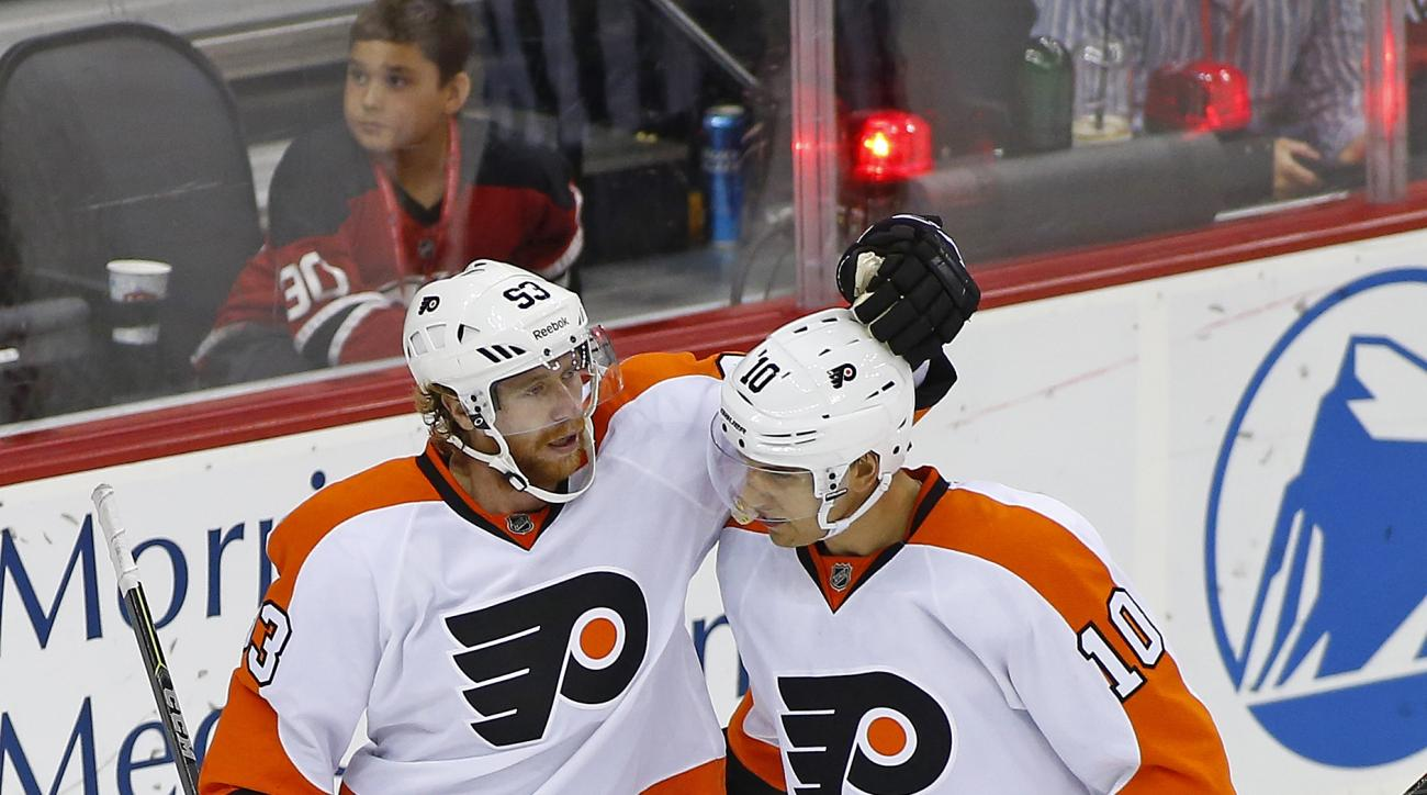 Philadelphia Flyers right winger Jakub Voracek (93) of the Czech Republic is congratulated by center Brayden Schenn (10) after scoring during the third period against the New Jersey Devils in an NHL preseason hockey game in Newark, N.J., Friday, Oct. 2, 2