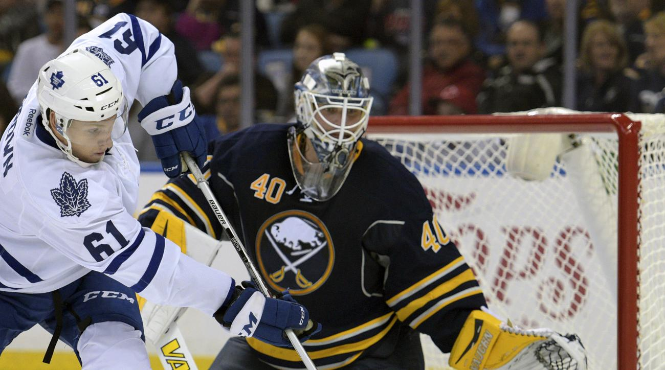 FILE - In this Sept. 29, 2015, file photo, Toronto Maple Leafs forward Connor Brown (61) deflects the puck at Buffalo Sabres goaltender Robin Lehner (40), of Sweden, during the second period of a preseason NHL hockey game in Buffalo, N.Y. Buffalo Sabres g