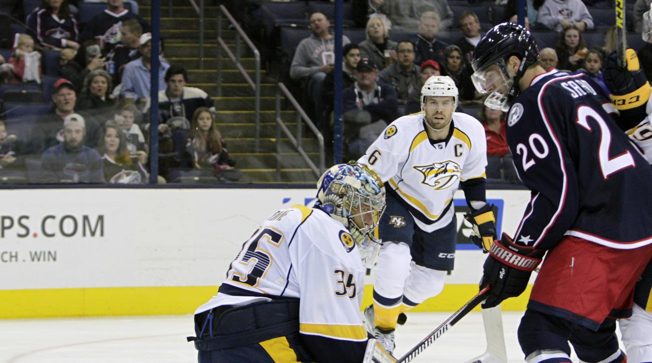 Columbus Blue Jackets' Brandon Saad, right, scores against Nashville Predators' Pekka Rinne (35), of Finland, during the second period of an NHL preseason hockey game Saturday, Oct. 3, 2015, in Columbus, Ohio. (AP Photo/Jay LaPrete)