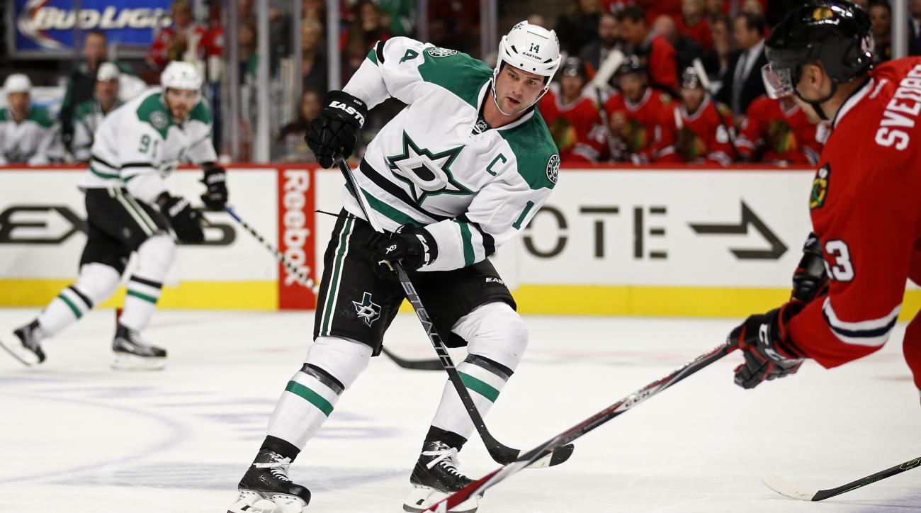 Dallas Stars left wing Jamie Benn (14) passes against the Chicago Blackhawks during the first period of a preseason NHL hockey game Saturday, Oct. 3, 2015, in Chicago. (AP Photo/Andrew A. Nelles)