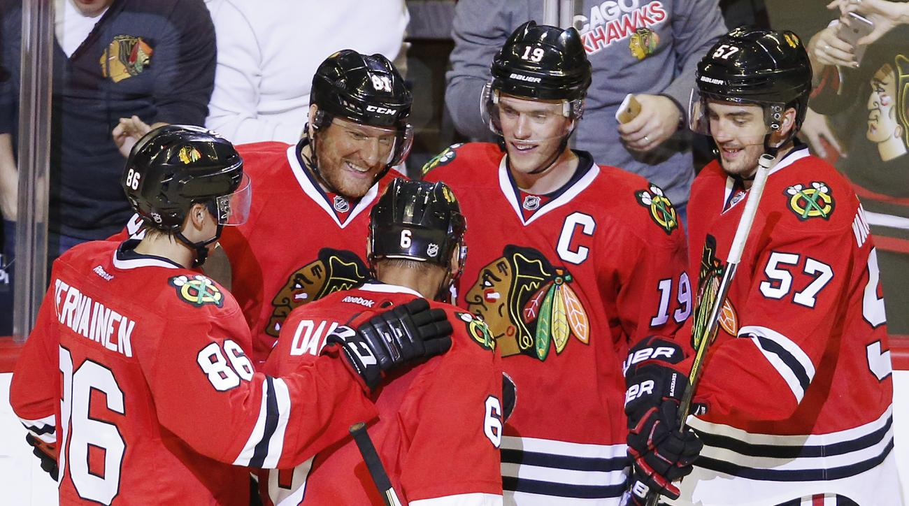 Chicago Blackhawks right wing Marian Hossa (81), second from left, celebrates his goal against the Dallas Stars with teammates during the third period of a preseason NHL hockey game Saturday, Oct. 3, 2015, in Chicago. (AP Photo/Andrew A. Nelles)