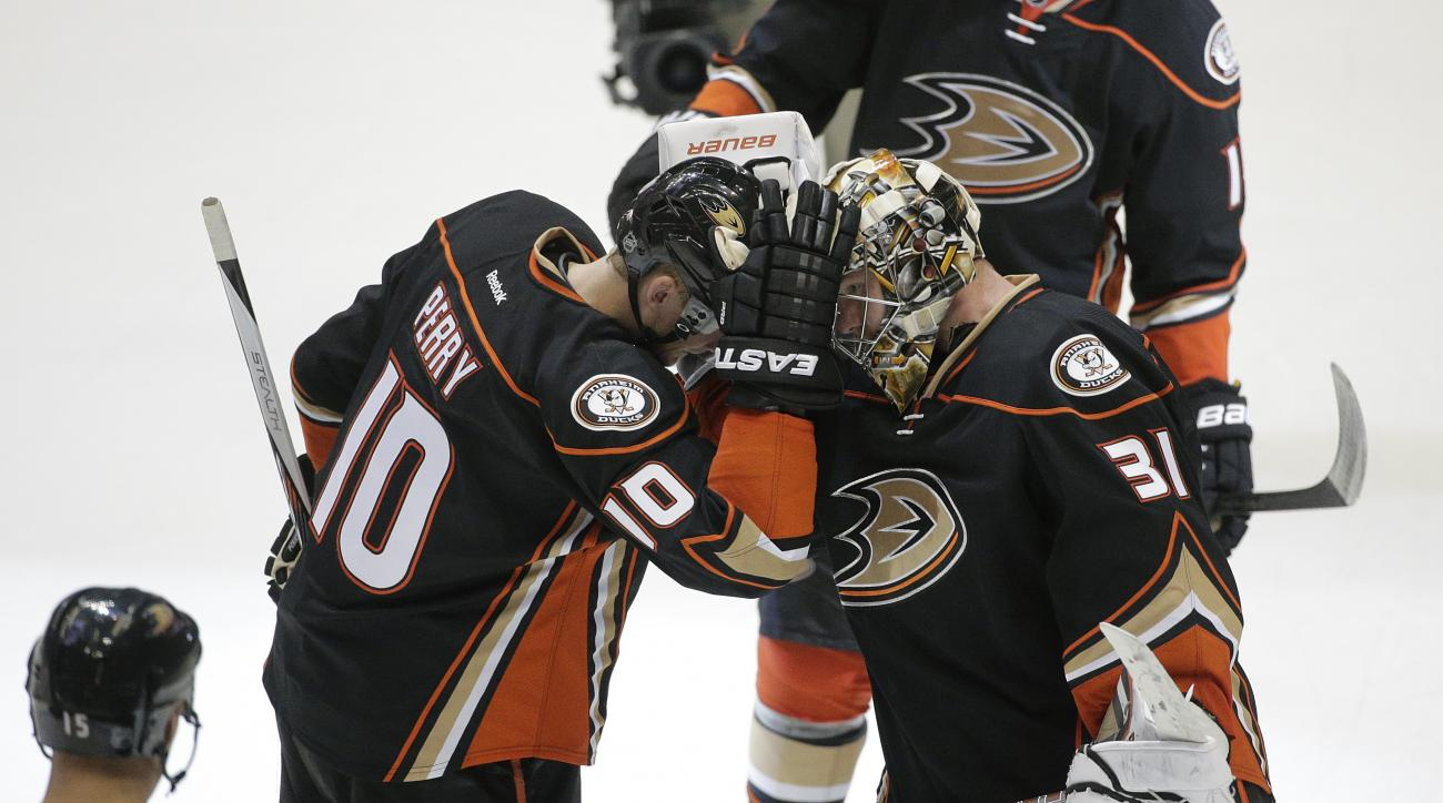 Anaheim Ducks' Corey Perry, left, and goalie Frederik Andersen, of Denmark, celebrate their team's 5-1 win against the San Jose Sharks in an NHL preseason hockey game, Saturday, Oct. 3, 2015, in Anaheim, Calif. (AP Photo/Jae C. Hong)