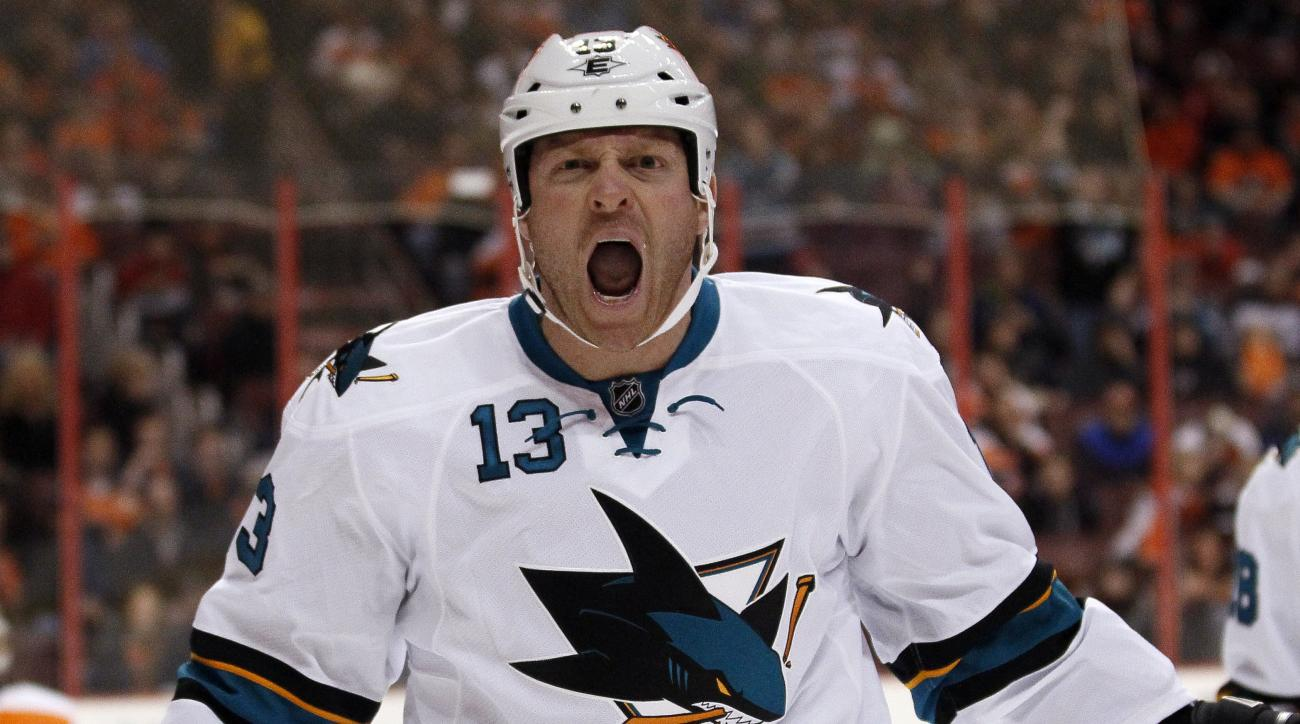 San Jose Sharks' Raffi Torres shouts after scoring during the first period of an NHL hockey game against the Philadelphia Flyers, Thursday, Feb. 27, 2014, in Philadelphia. (AP Photo/Tom Mihalek)