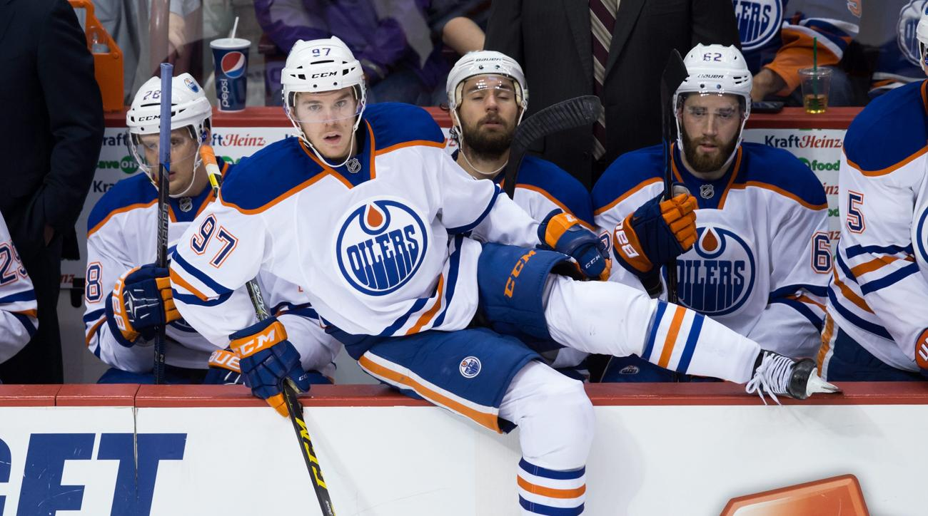 "FILE - In this Oct. 3, 2015, file photo, Edmonton Oilers' Connor McDavid (97) comes off the bench during the second period of a preseason NHL hockey game in Vancouver, British Columbia. Wayne Gretzky was ""The Great One"" and Mario Lemieux was ""The Magnific"