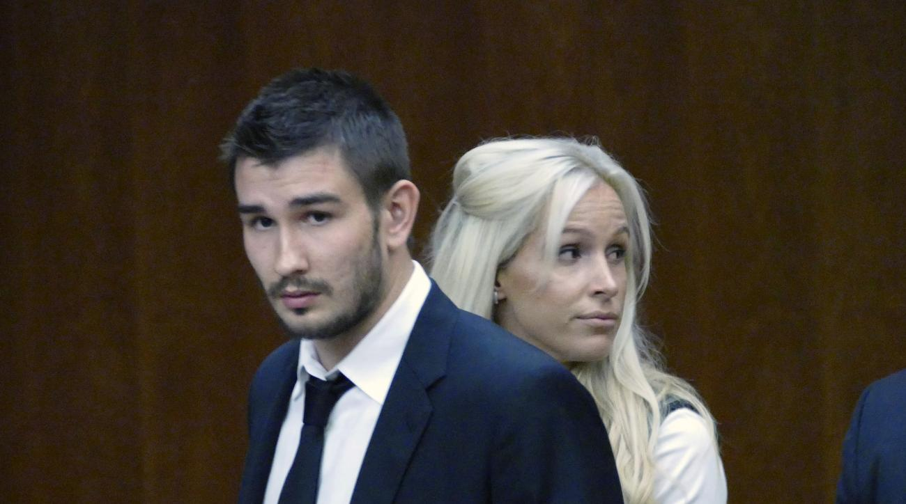 FILE - In this July 2, 2015, file photo, Los Angeles Kings' Slava Voynov enters Superior Court with his wife, Marta Varlamova, in Torrance, Calif. The former Kings defenseman pleaded no contest in July to a misdemeanor charge of domestic violence against