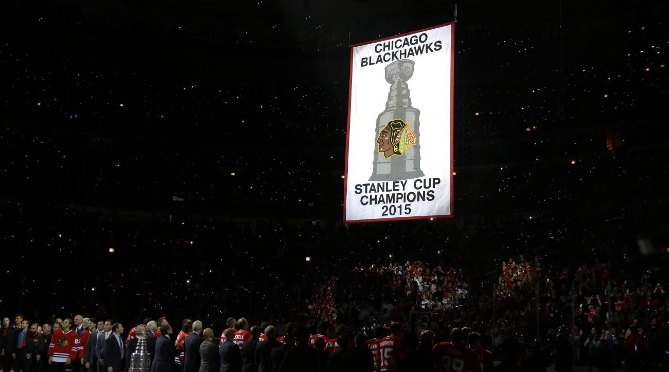 The Chicago Blackhawks' Stanley Cup championship banner is raised to the United Center ceiling during a ceremony before an NHL hockey game between the Blackhawks and the New York Rangers, Wednesday, Oct. 7, 2015, in Chicago. (AP Photo/Nam Y. Huh)