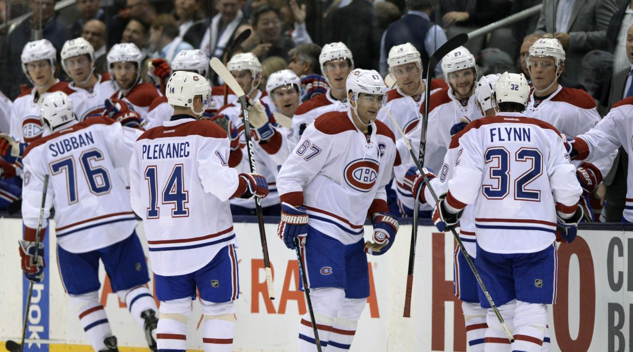 Montreal Canadiens players celebrate defeating the Toronto Maple Leafs 3-1 in an NHL hockey game, Wednesday, Oct. 7, 2015 in Toronto.  (Frank Gunn/The Canadian Press via AP) MANDATORY CREDIT