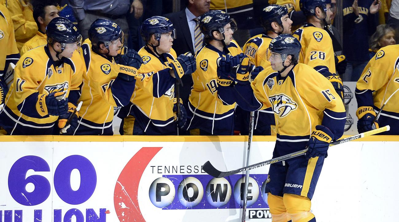 Nashville Predators right wing Craig Smith (15) is congratulated after scoring a goal in the first period of an NHL hockey game against the Carolina Hurricanes, Thursday, Oct. 8, 2015, in Nashville, Tenn. (AP Photo/Mark Zaleski)