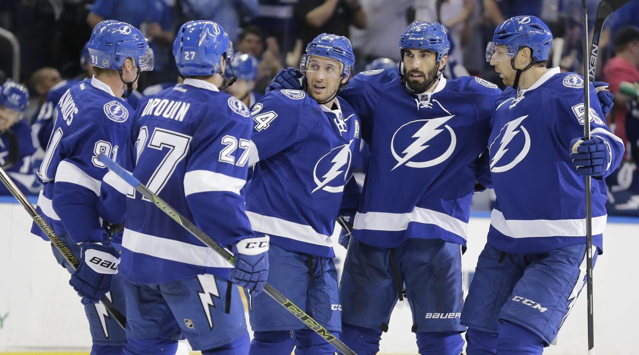 Tampa Bay Lightning defenseman Jason Garrison, second from right, celebrates his goal against the Philadelphia Flyers with teammates from left to right, Steven Stamkos, Jonathan Drouin, Ryan Callahan and Braydon Coburn during the second period of an NHL h