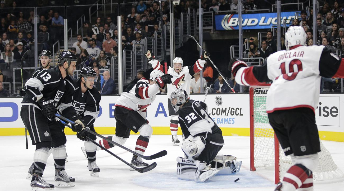 Arizona Coyotes' Oliver Ekman-Larsson, center left, of Sweden, celebrates his goal against Los Angeles Kings goalie Jonathan Quick, center right, during the first period of an NHL hockey game, Friday, Oct. 9, 2015, in Los Angeles. (AP Photo/Jae C. Hong)