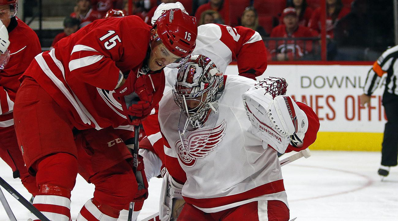 Carolina Hurricanes' Andrej Nestrasil (15) of Czech Republic, has his shot blocked by Detroit Red Wings goalie Petr Mrazek (34) of Czech Republic, during the second period of an NHL hockey game, Saturday, Oct. 10, 2015, in Raleigh, N.C. (AP Photo/Karl B D