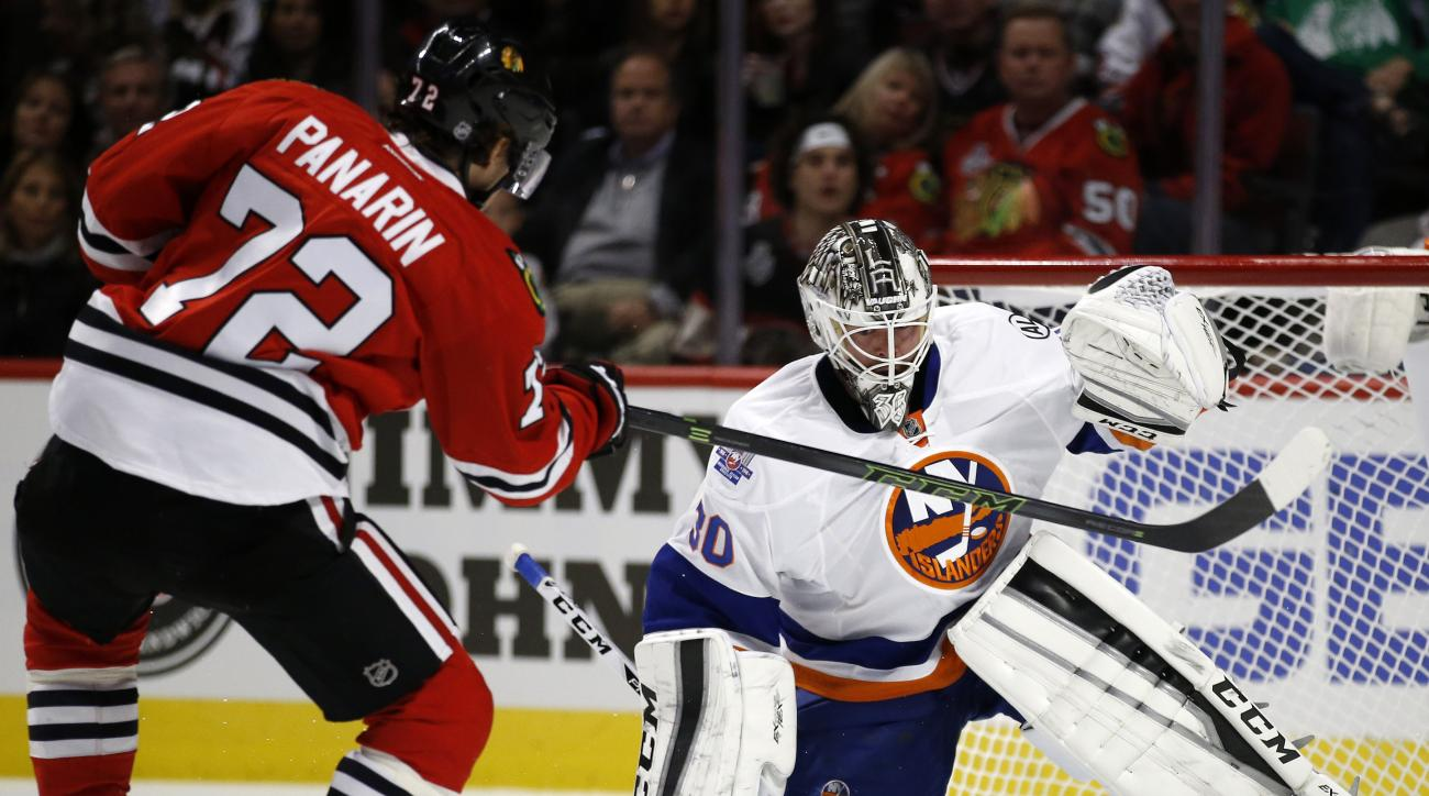 New York Islanders goalie Jean-Francois Berube (30) blocks a shot by Chicago Blackhawks left wing Artemi Panarin (72) during the second period of an NHL hockey game Saturday, Oct. 10, 2015, in Chicago. (AP Photo/Andrew A. Nelles)