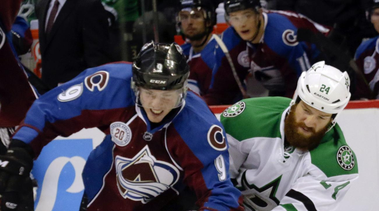 Colorado Avalanche center Matt Duchene (9) skates for the puck against Dallas Stars defenseman Jordie Benn in the second period of an NHL hockey game Saturday, Oct. 10, 2015, in Denver. (AP Photo/Joe Mahoney)