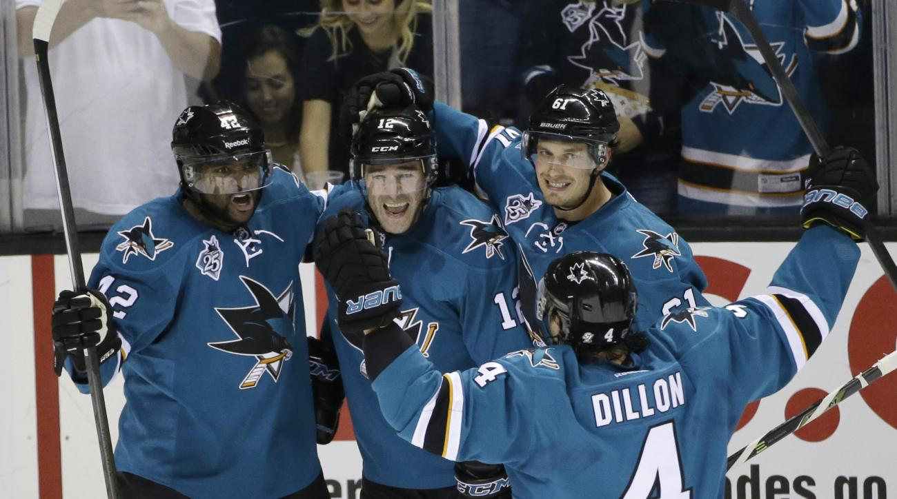 San Jose Sharks' Patrick Marleau (12) celebrates his goal with teammates Joel Ward (42), Justin Braun (61) and Brenden Dillon (4) during the second period of an NHL hockey game against the Anaheim Ducks Saturday, Oct. 10, 2015, in San Jose, Calif. (AP Pho