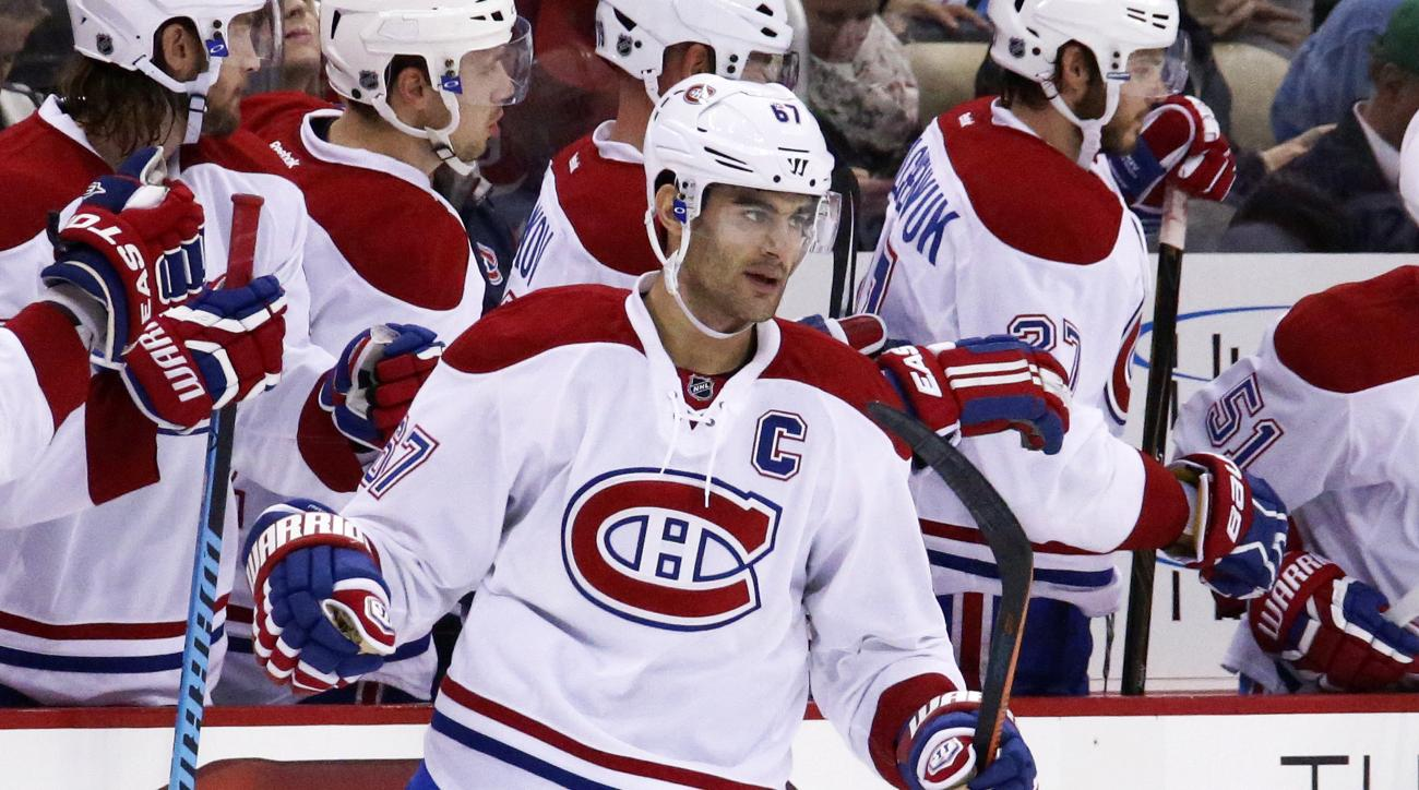 Montreal Canadiens' Max Pacioretty (67) returns to the bench after scoring his second goal of the game in the second period of an NHL hockey game against the Pittsburgh Penguins in Pittsburgh Tuesday, Oct. 13, 2015.(AP Photo/Gene J. Puskar)