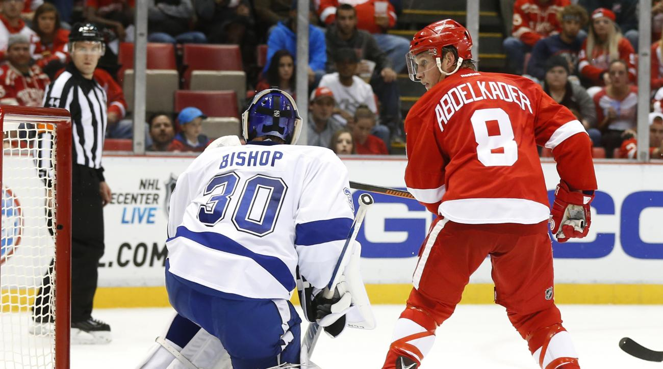 CORRECTS TO WATCHES A SHOT FROM DEFLECTS A SHOT - Detroit Red Wings left wing Justin Abdelkader (8) watches a Gustav Nyquist shot for a goal against Tampa Bay Lightning goalie Ben Bishop (30) in the second period of an NHL hockey game in Detroit Tuesday,