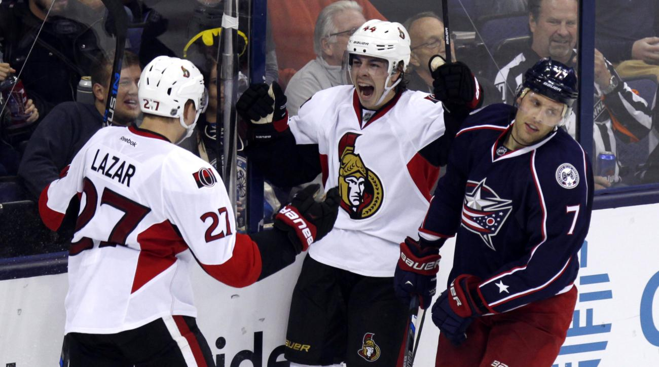Ottawa Senators' Jean-Gabriel Pageau (44) celebrates with teammate Curtis Lazar (27) in front of Columbus Blue Jackets' Jack Johnson (7) after Pageau scored a goal during the third period of an NHL hockey game in Columbus, Ohio, Wednesday, Oct. 14, 2015.