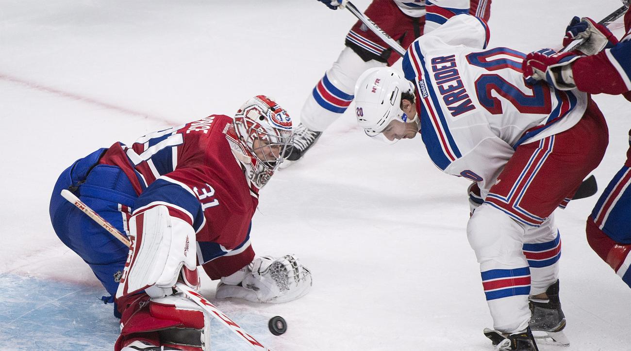 Montreal Canadiens goaltender Carey Price makes a save against New York Rangers' Chris Kreider during the second period of an NHL hockey game, Thursday, Oct. 15, 2015 in Montreal. (Graham Hughes/The Canadian Press via AP) MANDATORY CREDIT
