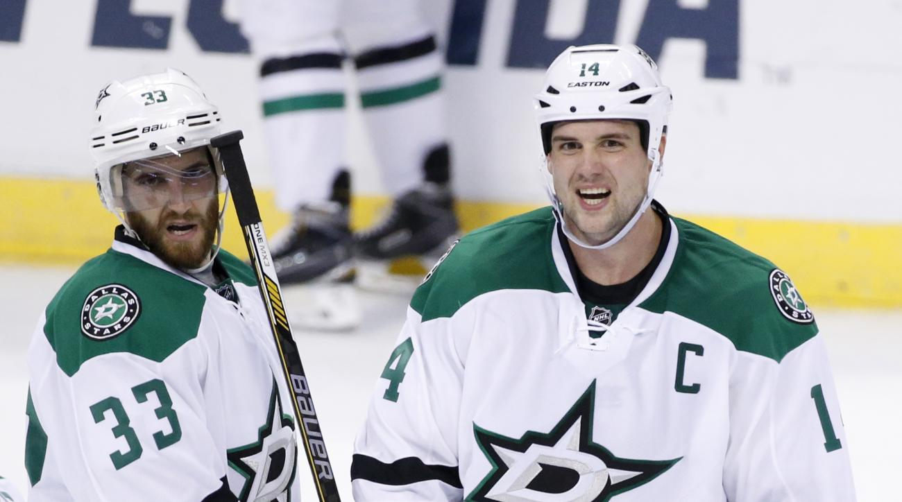 Dallas Stars left wing Jamie Benn (14) celebrates with defenseman Alex Goligoski (33) and center Tyler Seguin (91) after Benn scored a goal during the third period of an NHL hockey game against the Florida Panthers, Saturday, Oct. 17, 2015 in Sunrise, Fla