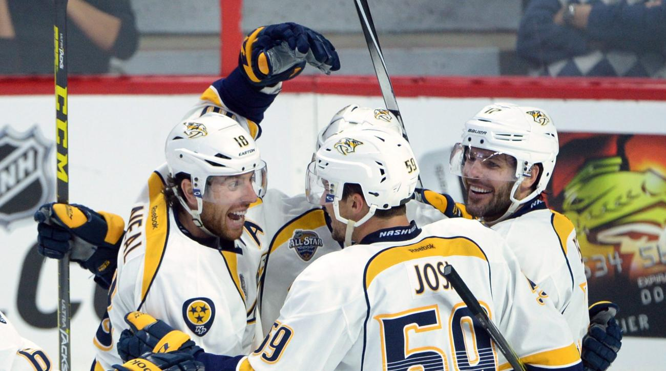 Nashville Predators' James Neal, left, celebrates a third-period goal with teammates against the Ottawa Senators during NHL hockey game action in Ottawa, Ontario, Saturday, Oct. 17, 2015. (Sean Kilpatrick/The Canadian Press via AP) MANDATORY CREDIT