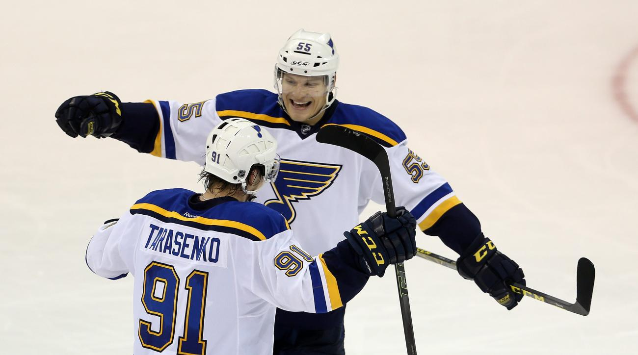 St. Louis Blues' Vladimir Tarasenko (91) and Colton Parayko (55) celebrate after Tarasenko scored against the Winnipeg Jets during third period NHL hockey action in Winnipeg, Sunday, Oct. 18, 2015. (Trevor Hagan/The Canadian Press via AP)