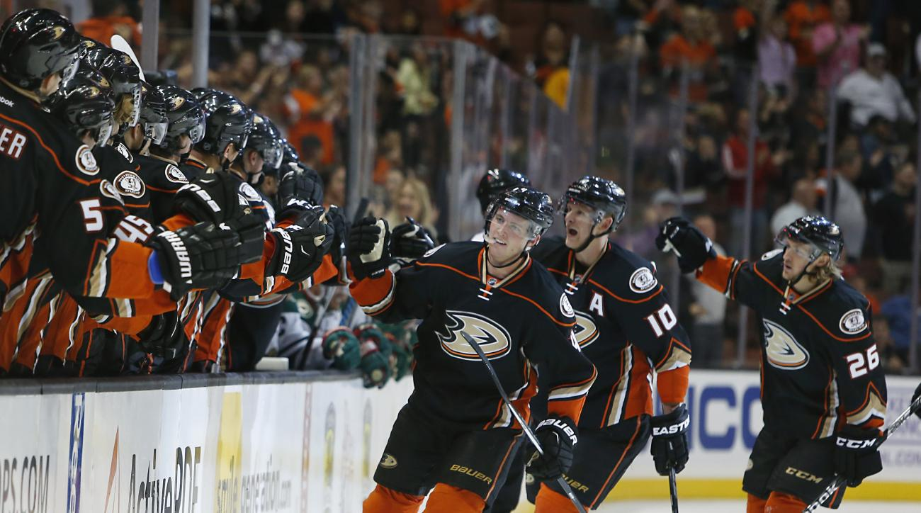 Anaheim Ducks' Cam Fowler, Corey Perry, and Carl Hagelin, from left, celebrate Fowler's goal in the first period of an NHL hockey game against the Minnesota Wild in Anaheim, Calif., Sunday, Oct.18, 2015. The Ducks won 4-1. (AP Photo/Christine Cotter)