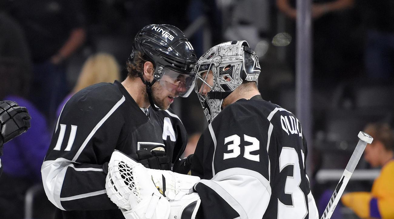 Los Angeles Kings center Anze Kopitar, of Slovenia, congratulates goalie Jonathan Quick after the Kings defeated the Colorado Avalanche 2-1 in an NHL hockey game, Sunday, Oct. 18, 2015, in Los Angeles. (AP Photo/Mark J. Terrill)